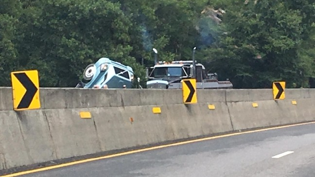 Tractor-trailer tips on I-40 east near Tennessee state line, backing