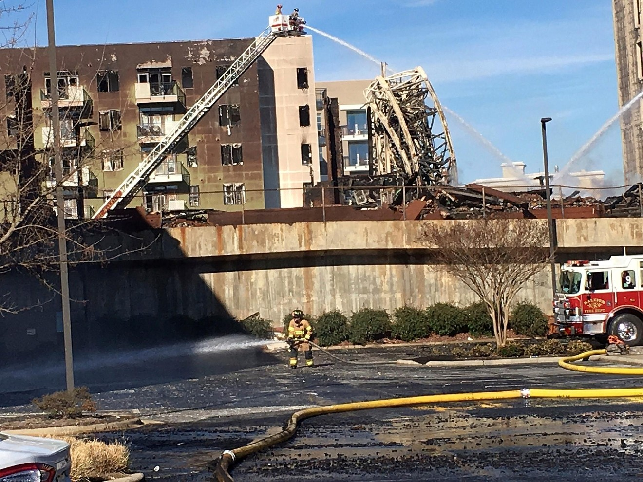 Firefighters Continue Efforts At An Apartment Building Under Construction Friday March 17 2017